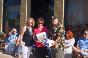 On behalf of Texas State Representative, Dennis Bonnen, District 25, Barbara Reece, District Director for State Representative Cindy Burkett, District 113, presents Paul and Donna a Texas Flag that was flown over the Texas State Capitol. A great honor indeed.